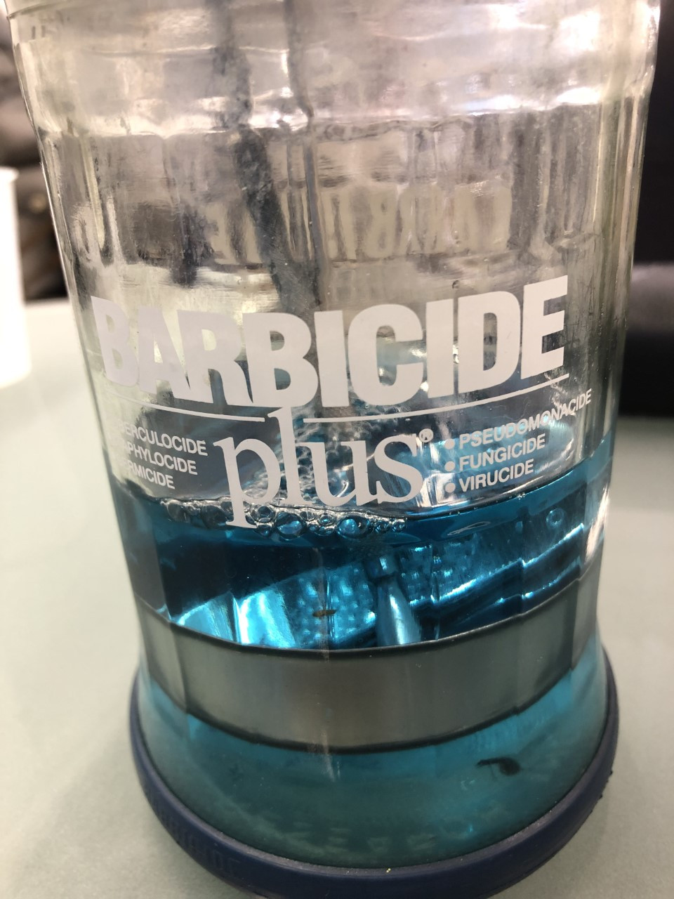 Disinfectant I found in a salon with floating debris and a fly!