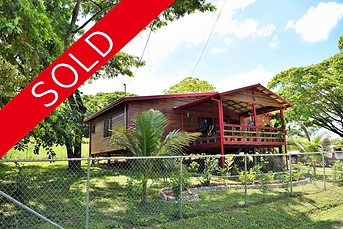 Sold Sign Two bed two bath wooden house.