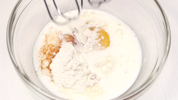 videoblocks-mixing-flour-with-eggs-and-m