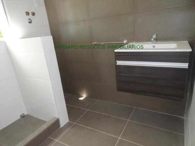 Baño con conexión para lavarropas