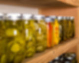 Canned goods on wooden storage shelves i
