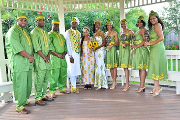 wedding ceremony with the couple posing with some friends and Dr. Akua