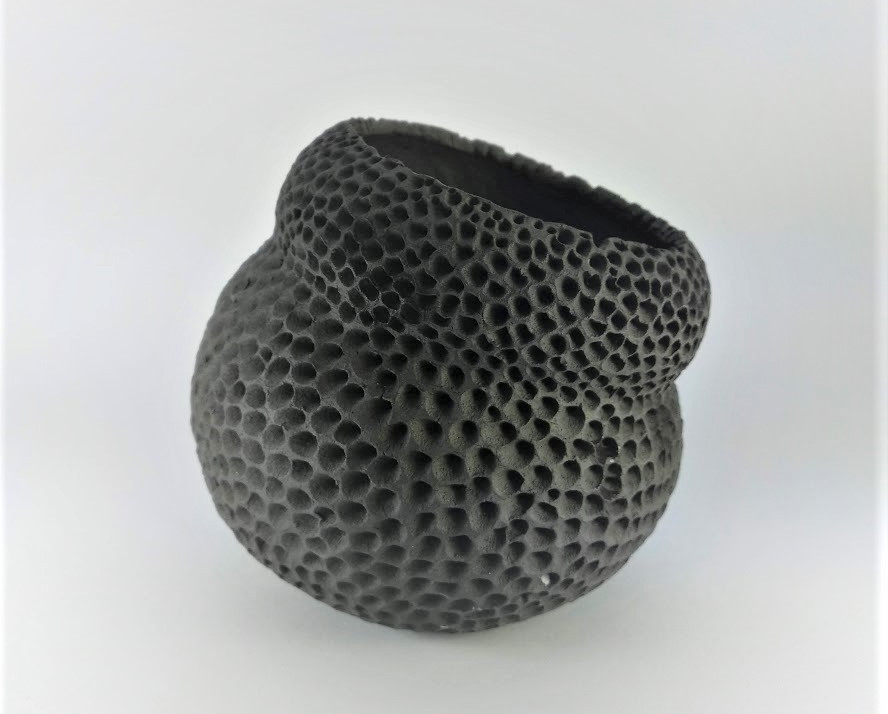 Black doted object H 12cm D 13cm