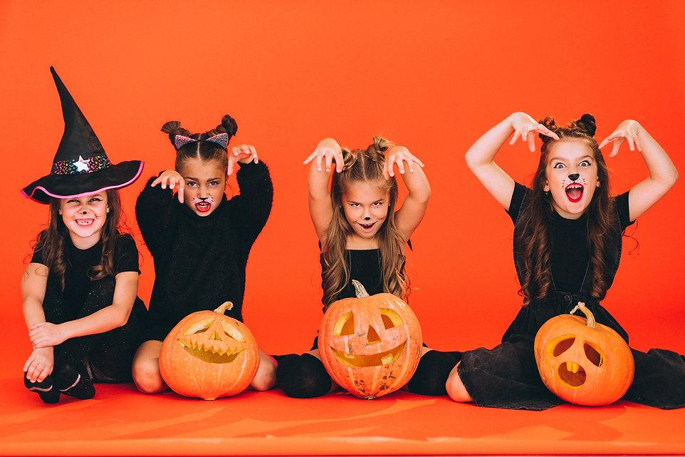 group-girls-dressed-halloween-costumes-studio.jpg