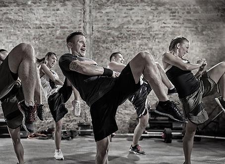group of people practicing kick, workou
