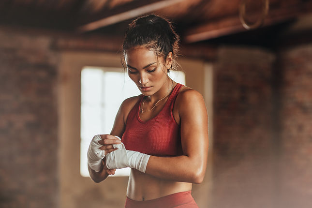 Female boxer wearing strap on wrist. Fit
