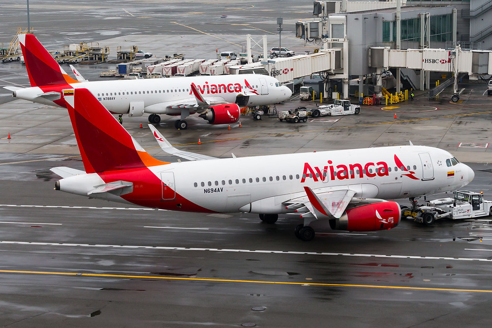 Avianca A319s from rooftop pool