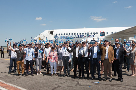 Airbus staff in front of A220