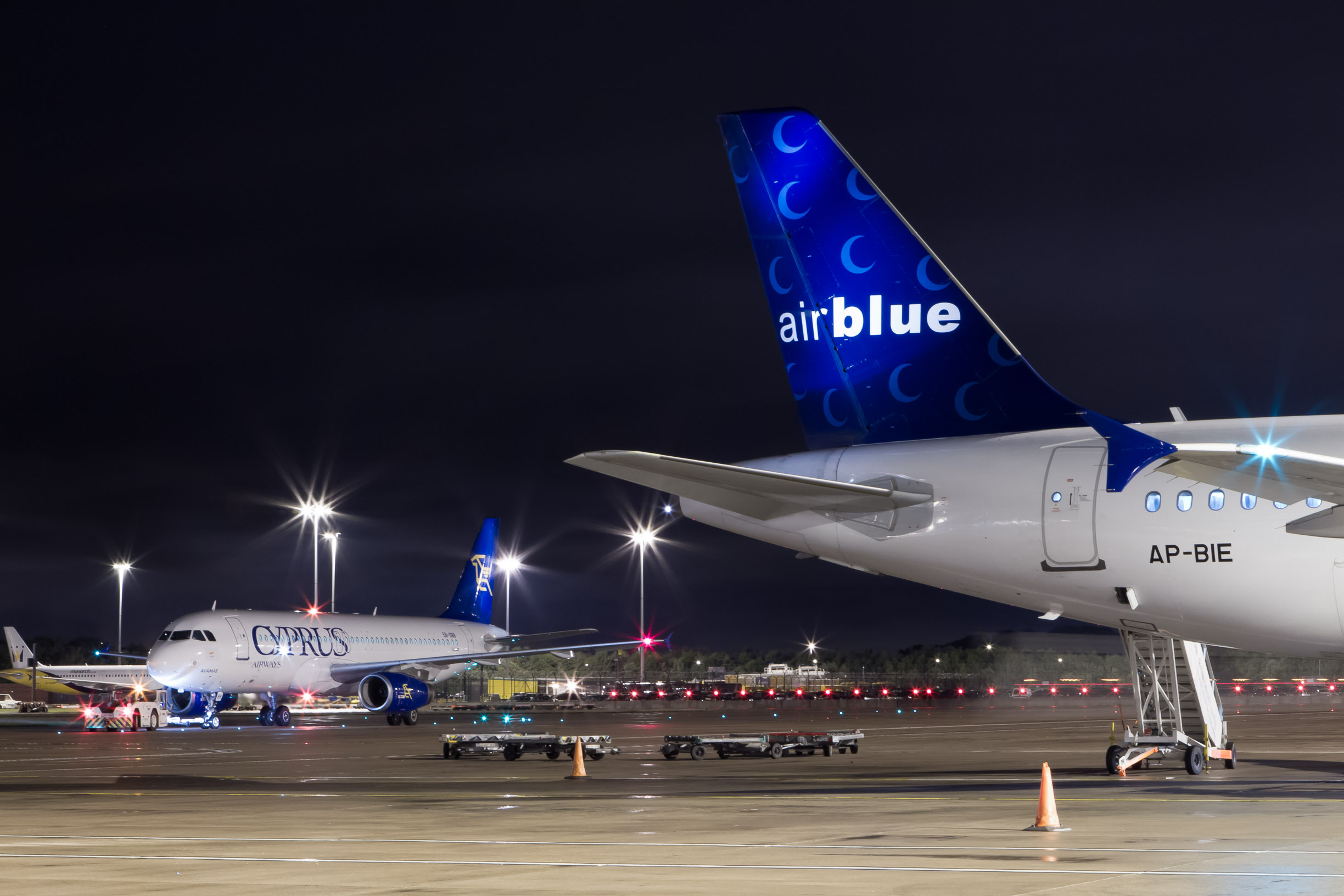 Airblue and Cyprus Airbus at night