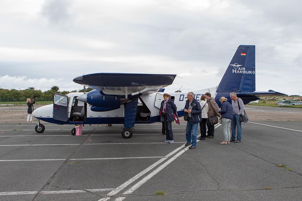 Passengers around Air Hamburg islander