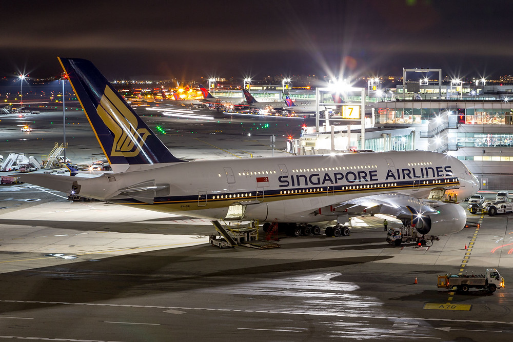 SIA A380 at night from rooftop pool