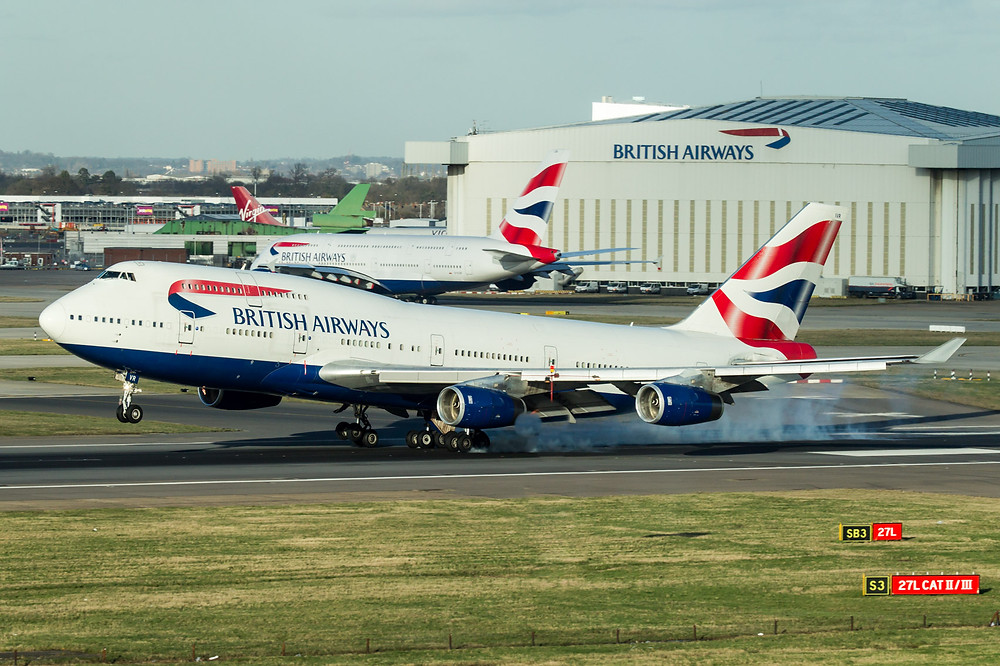 British Airways 747 lands at its London Heathrow base. One of the companies A380s sits in the background