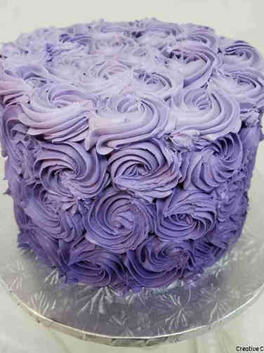 Feminine 22 Purple Rosettes Birthday Cake