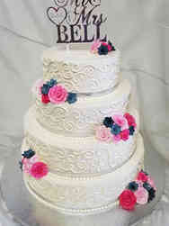 Simple 05 Pink and Navy Roses and Swirls Wedding Cake