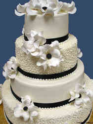 Floral 40 Magnolias and Cornelli Lace Wedding Cake