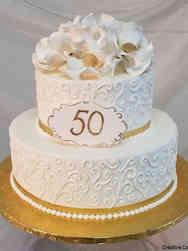 Anniversary 13 Simple Swirls and Magnolia 50th Anniversary Cake