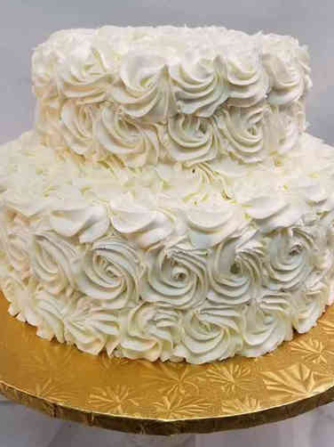 Trendy 07 White Rosettes Wedding Cake