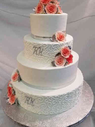Simple 11 Coral Roses and Swirls Wedding Cake
