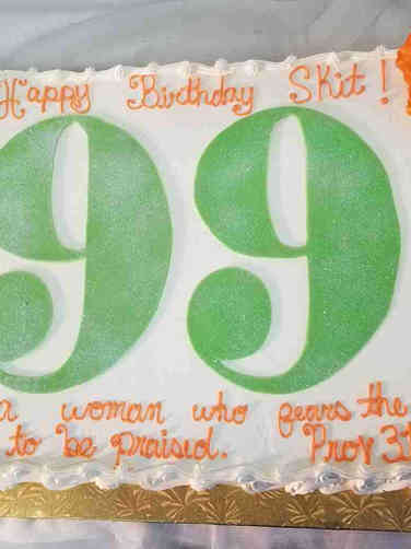 Numbers 32 Orange and Green 99th Birthday Cake