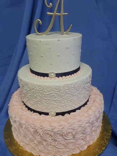 Elegant 18 Pink and White Textured Wedding Cake