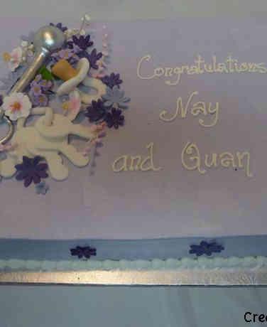 Neutral 40 Elegant Keys and Rattle Baby Shower Cake
