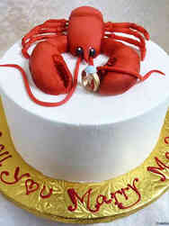 Unique 09 Lobster and Ring Proposal Cake