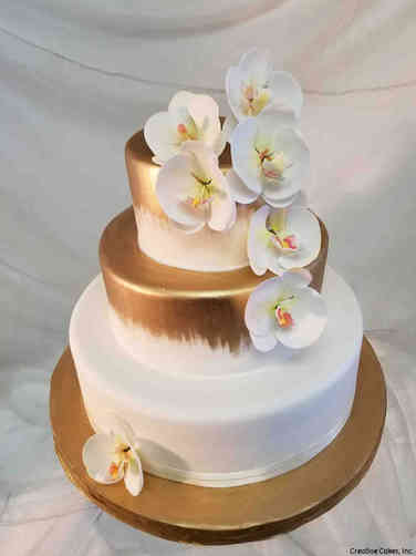 Trendy 24 Painted Gold Wedding Cake with Handmade Orchids