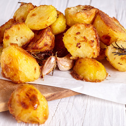 Goose fat potatoes with garlic corms and rosemary