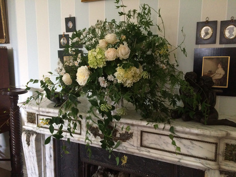 Large white funeral flower arrangement