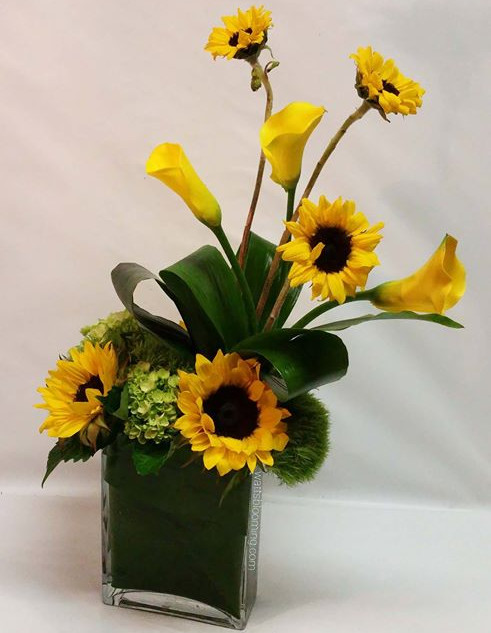 Modern cube vase with sunflowers