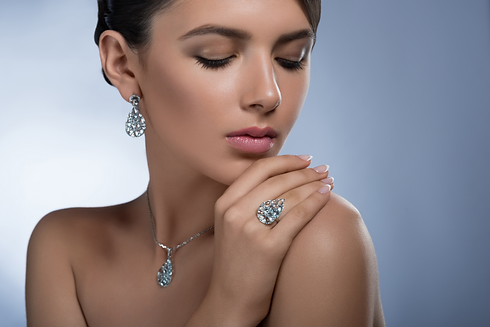 portrait-gorgeous-young-elegant-female-wearing-diamond-earrings-ring-necklace-posing-with-