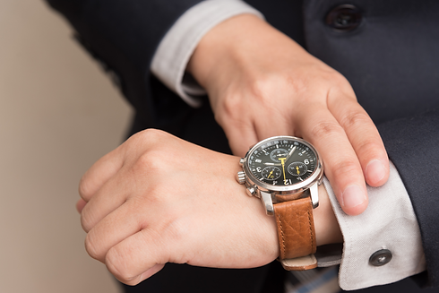 businessman-checking-time by H and Z Diamond Centre.png
