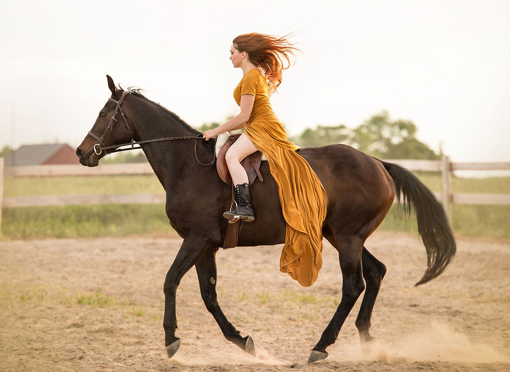 Woman with scoliosis riding a horse, living an active life