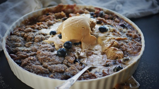 Spiced apple and blueberry crumble with salted caramel ice cream