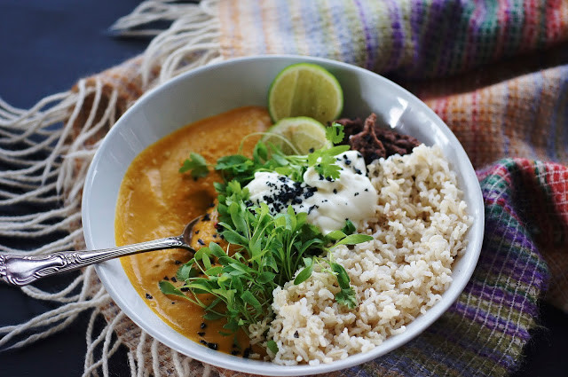 Spiced pumpkin soup with brown rice, blackbeans and lime whipped feta