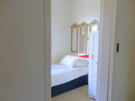 The Suite's single partitioned room