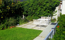 Private garden with patio furniture