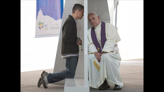 Pope Francis hears the confession of a young penitent at World Youth Day in Rio de Janeiro.