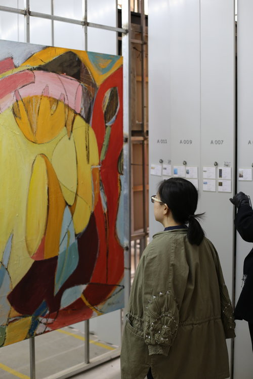 Lulu viewing Monique's artwork at Being 3 Gallery