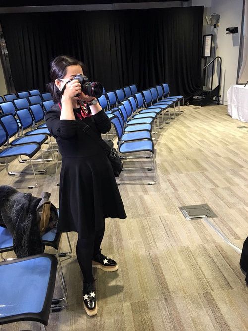 Lulu taking photos during preparation of the panel discussion, at the Beijing American Center, U.S. Embassy