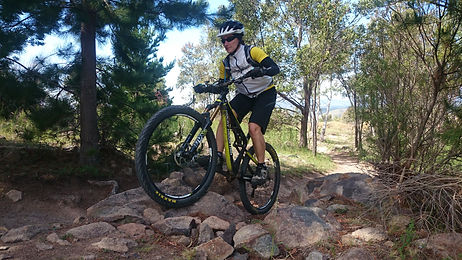 Mags riding a rock garden at Mt Stromlo