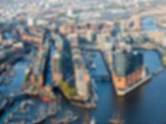 csm_Luftaufnahme-HafenCity-und-Speichers