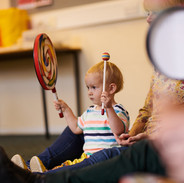 Mini musicians playing percusssion