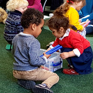 Mini musicians selecting instruments