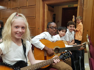 Children playing the guitar