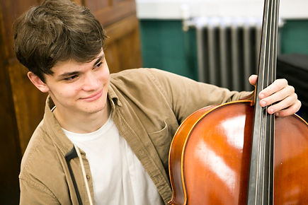 A young musician in his cello lesson