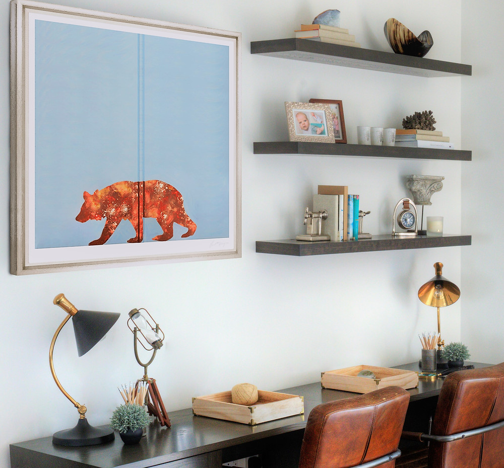 A pair of children's desks with leather chairs and floating shelves above. Interior design by Vesta Design