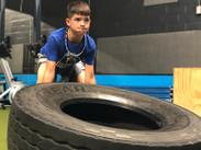 Kid Lifting Tire