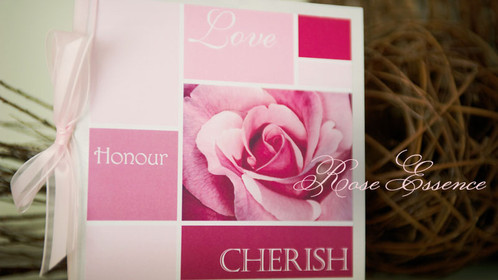 Rose essence invitation to love honor and cherishose simple words filled with so much meaning are inscribed on the front of this invitation a picture of a rose and blocks of stopboris Images