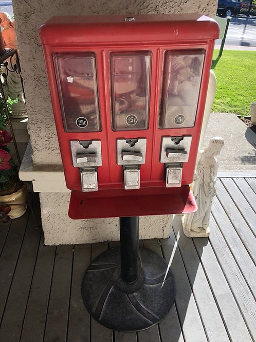 Red metal coin operated candy dispenser machine